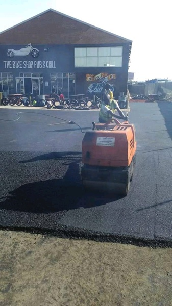 TARRING WITH HOT ASPHALT picture
