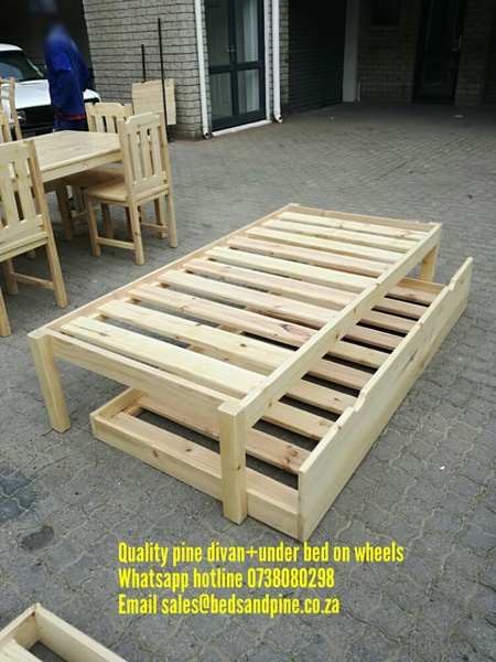 Pine divans with under beds on wheels picture
