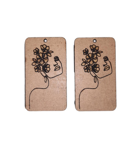 Laser cut rectangular shaped earring set. with engraved female face. picture