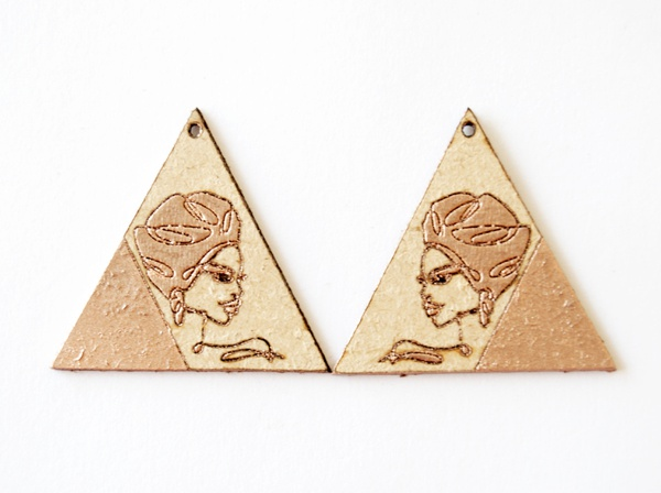 Laser cut earing set with rose gold paint and engraved female face. picture