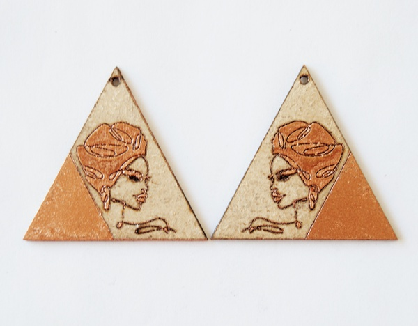 Laser cut earing set with bronze paint and engraved female face. picture