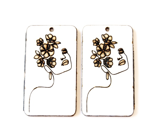 Laser cut rectangular shaped earring set. painted with engraved female face. picture