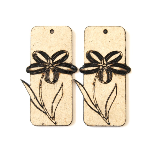 Laser cut rectangle earring with engraved flower. picture