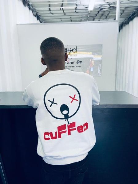 Cuffed graffiti sweater picture
