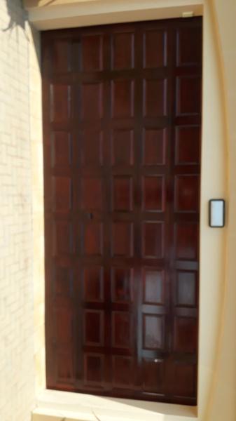 Sanding and varnish garage doors picture