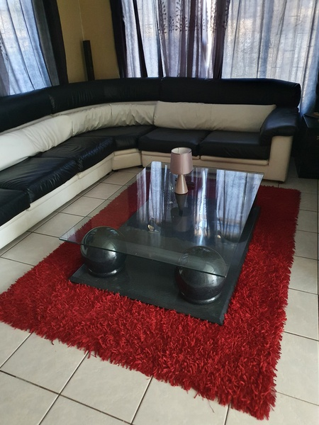Curve lounge suite with table and carpet with small lamp picture
