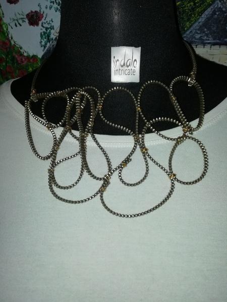 Machena zip designer neck piece. picture