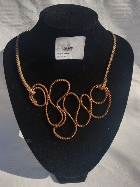 Thando zip designer neck piece picture