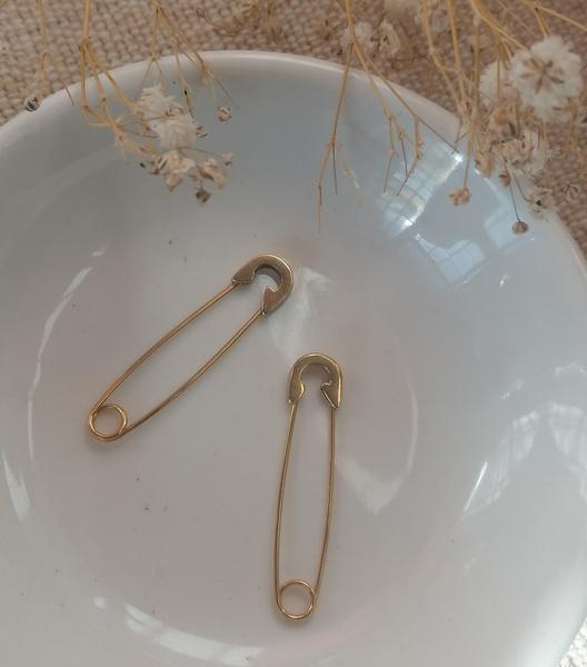 Fibula pin earings picture