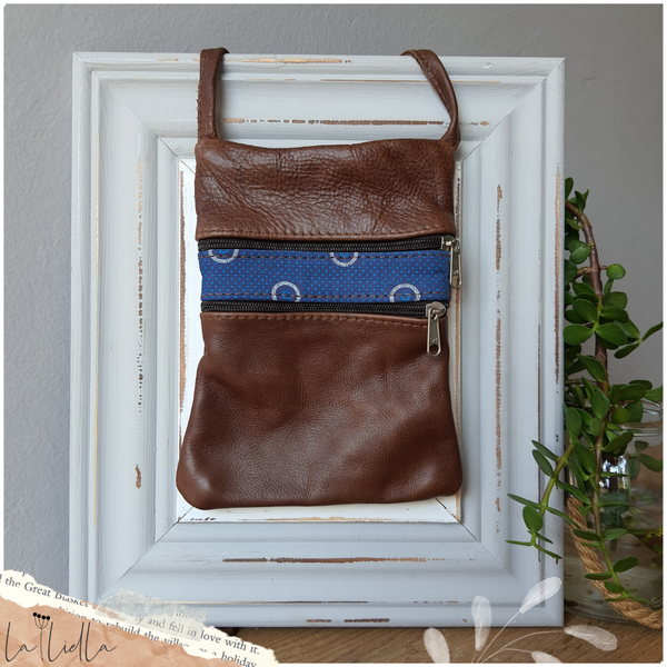 #25 blue & white shweshwe strip | brown leather picture