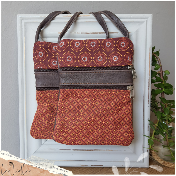 #35 maroon and orange shweshwe | brown leather picture